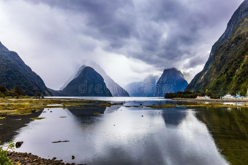 The Milford Sound fjord reflects mountains stock photos
