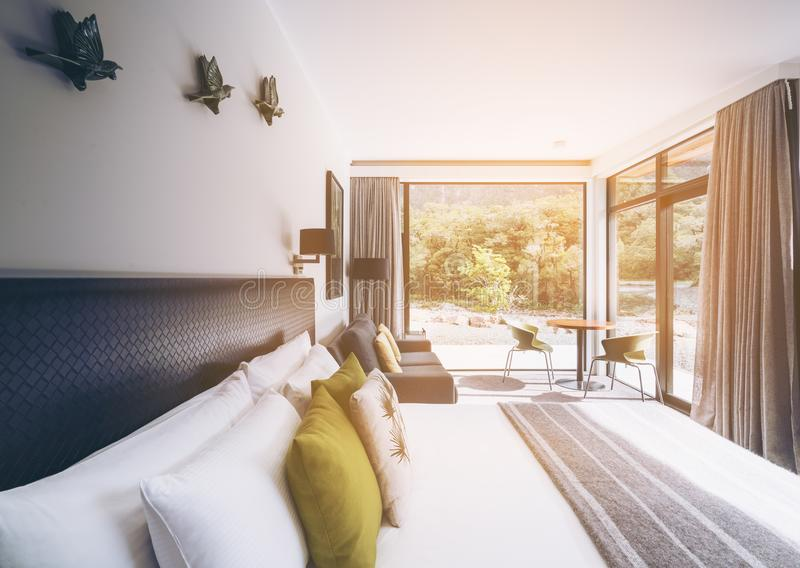 Luxury bedroom interior at Milford Sound Lodge stock photo