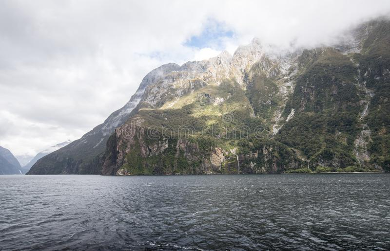 Milford Sound is a world renowned natural wonder with towering peaks, cascading waterfalls and amazing wildlife. royalty free stock images