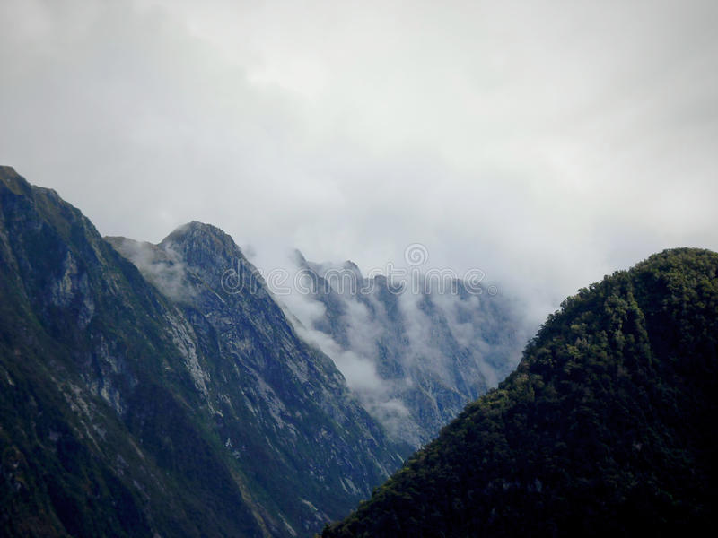 Milford Sounds clouds over the fjords stock photography