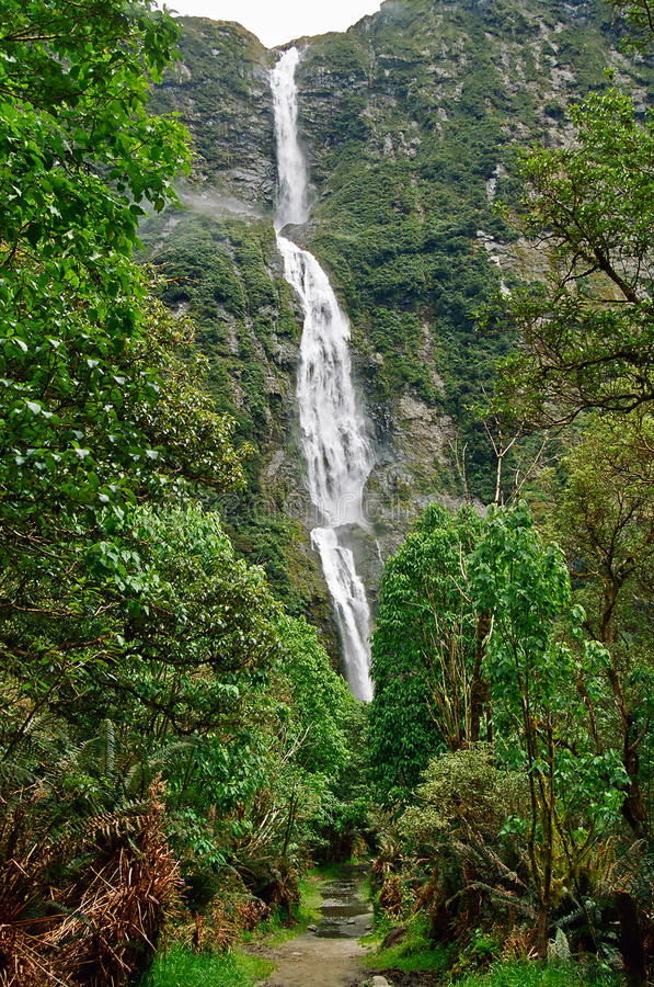 Milford Track waterfall, New Zealand stock images