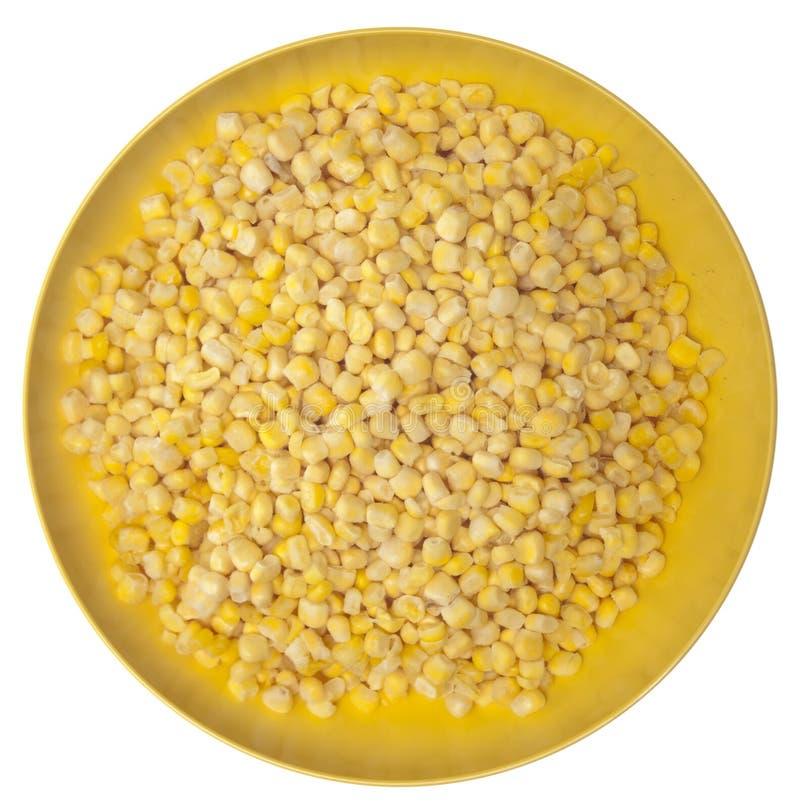 Milho congelado em uma bacia amarela vibrante fotografia de stock royalty free