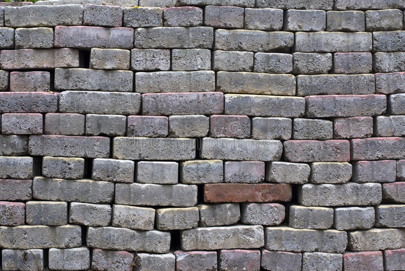 Milieux gris de mur de briques photographie stock