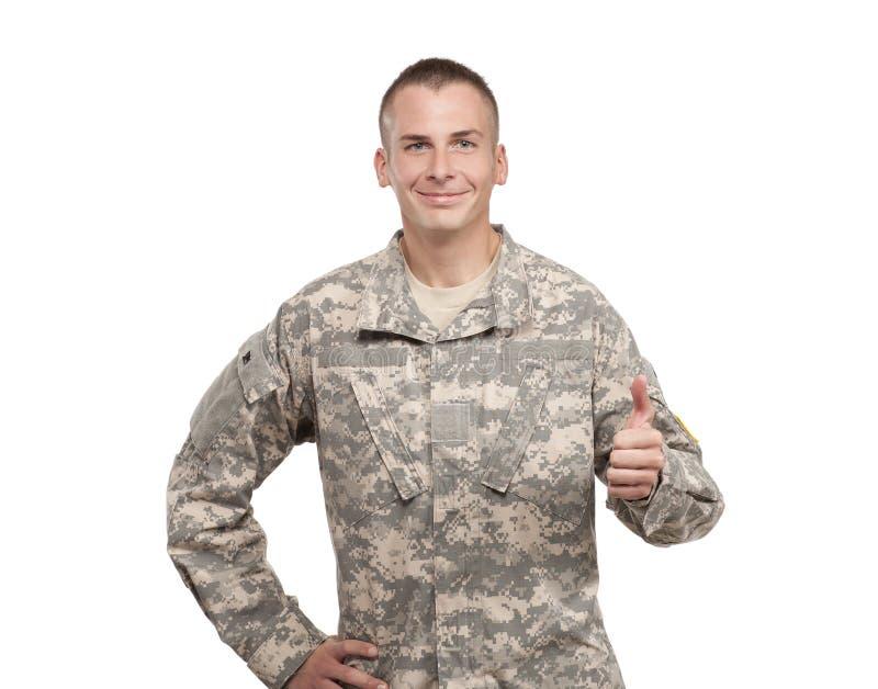 Lycklig soldat som ger upp tum arkivbilder