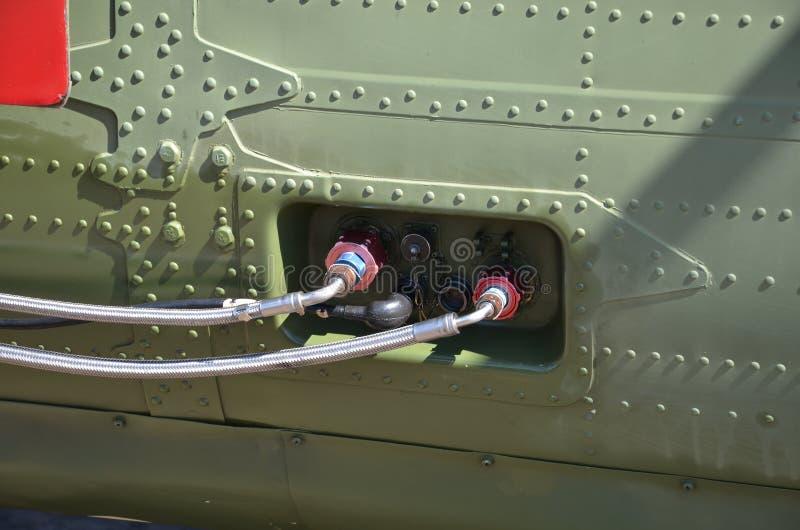 Militärhubschrauber-Tarnung Militärflugzeugdetailtarnung Ansicht über Rumpf mit Plattenlinien- und -steigungsfarben stockfotos