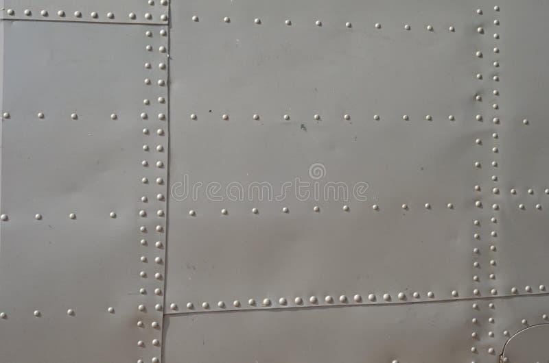 Militaire Helikoptercamouflage De camouflage van het militaire vliegtuigendetail Weergeven over fuselage met van de paneellijn en stock afbeeldingen