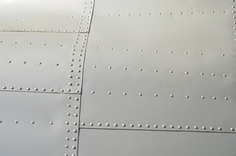 Militaire Helikoptercamouflage De camouflage van het militaire vliegtuigendetail Weergeven over fuselage met van de paneellijn en stock fotografie