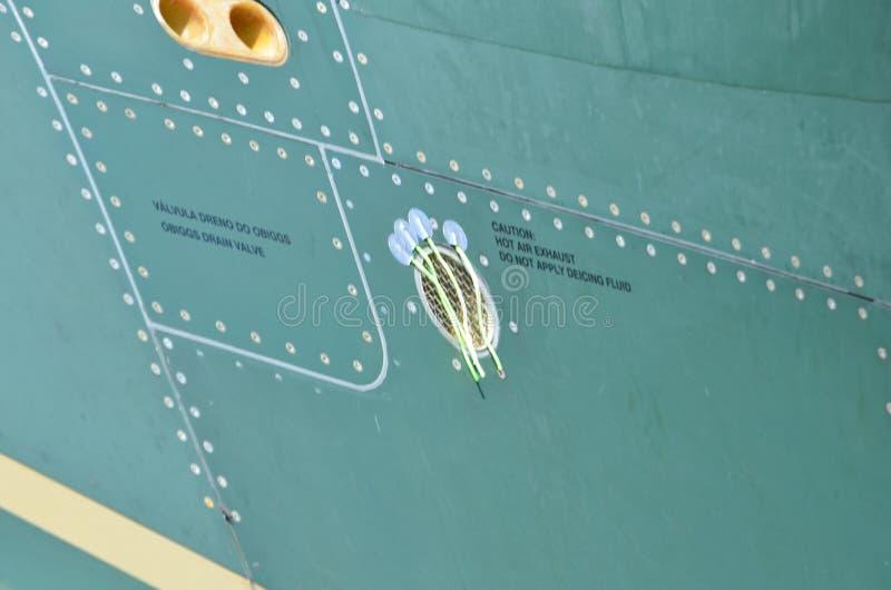 Militaire Helikoptercamouflage De camouflage van het militaire vliegtuigendetail Weergeven over fuselage met van de paneellijn en stock foto's