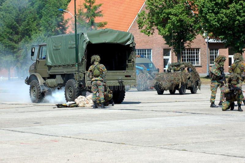 Militaire interventie, redding stock foto