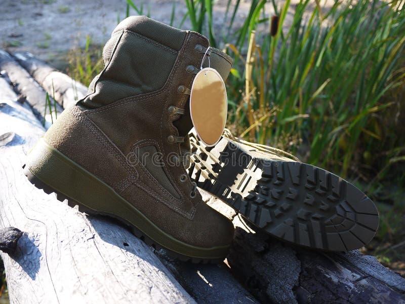 Militaire laarzen voor mensen Worden gebruikt voor materiaal en speciale strijdkrachten details stock afbeelding