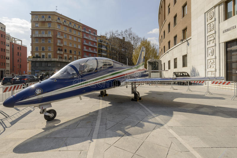 Militar jet trainer in city center, Milan, Italy royalty free stock photography