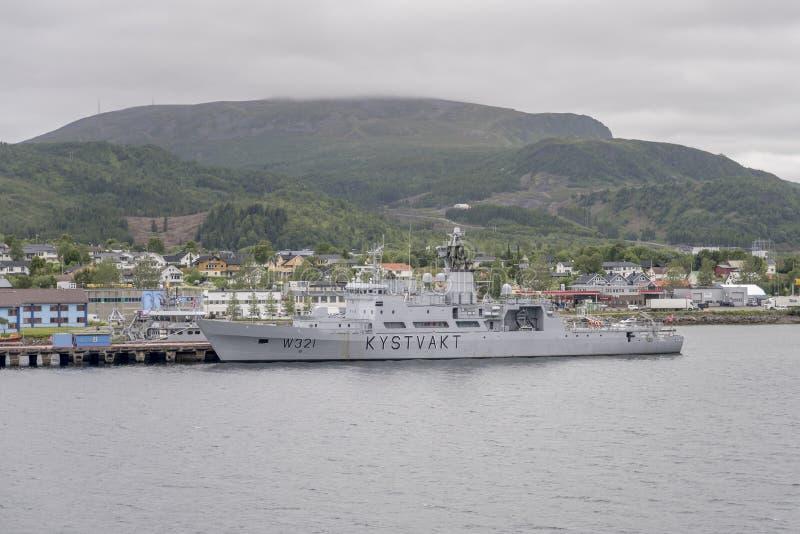 Militar ship moored at Sortland, Norway. SORTLAND, NORWAY - July 06 2019: military ship moored in fjord, shot under bright summer light  on july 06, 2019 at royalty free stock photography