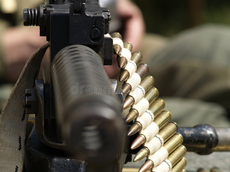 Military. Soldiers in scene and gun royalty free stock photo