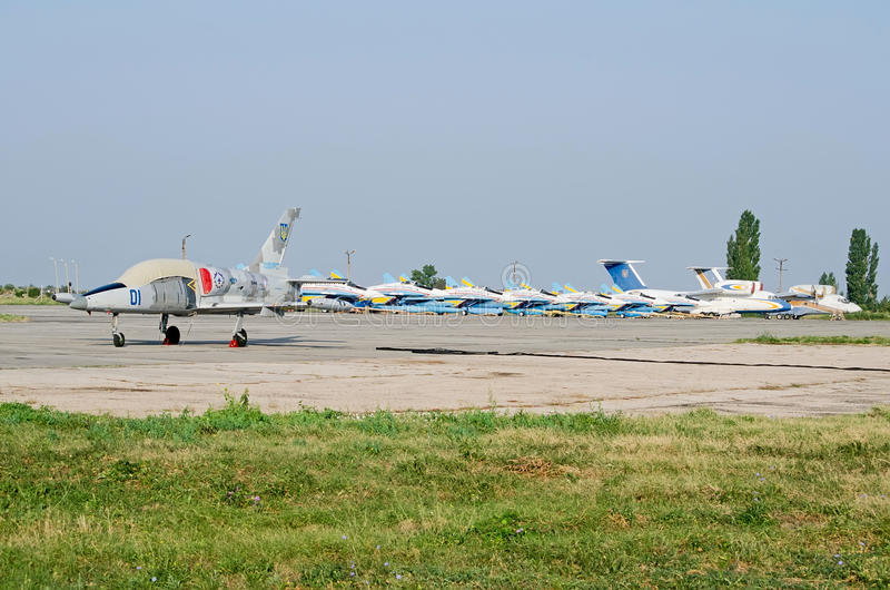 Military aircraft at the airfield in the Crimea. Military aircraft MiG-29 aerobatic team Ukrainian Falcons parked military airport on August 11, 2013 in Feodosia royalty free stock photo