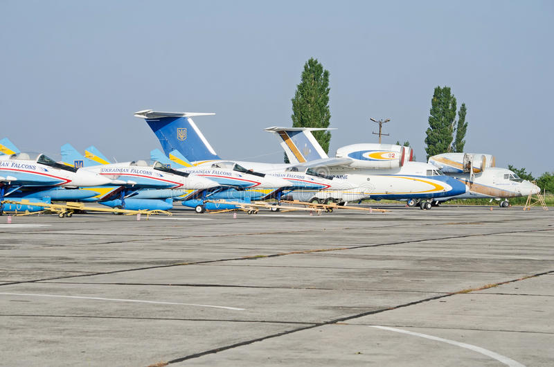 Military aircraft at the airfield in the Crimea. Military aircraft MiG-29 aerobatic team Ukrainian Falcons parked military airport on August 11, 2013 in Feodosia royalty free stock images