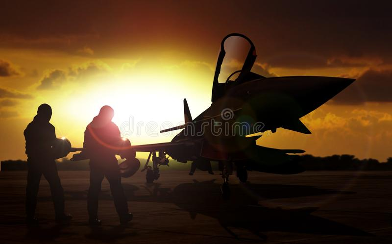 Military aircraft on airfield with pilot walking. Towards the aircraft royalty free stock photography