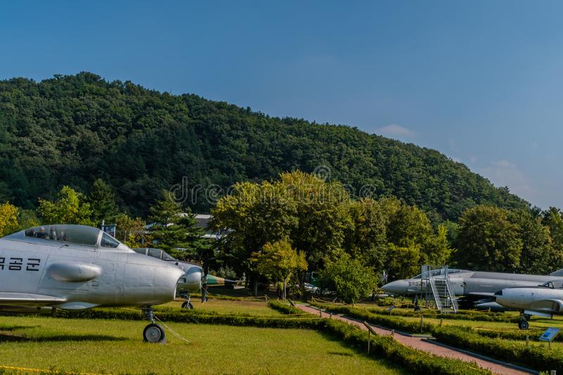 Military aircraft on display. Daejeon, South Korea; September 29, 2019: Military aircraft on display in public park at National Cemetery stock images
