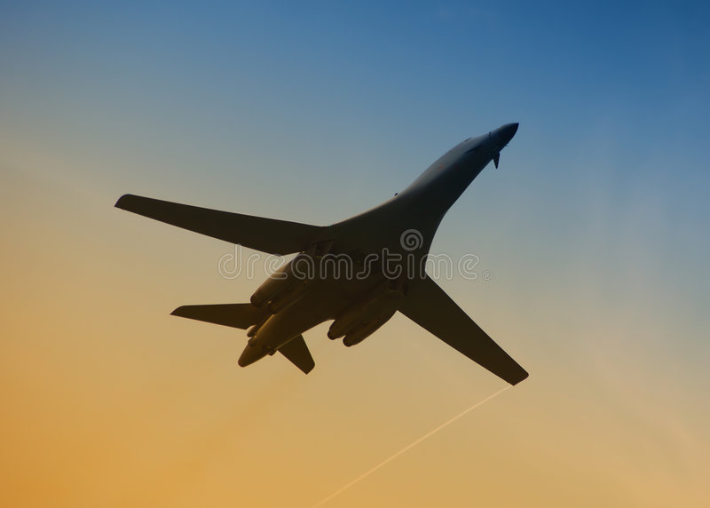 Military aircraft in flight. Bottom view of modern military jet in flight stock photos