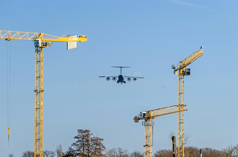 Military aircraft landing at the airport Berlin-Tegel over the residential area stock image