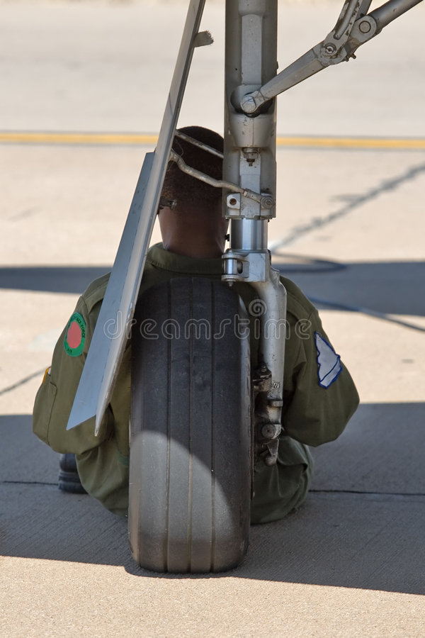 Military airplane pilot. Resting on the wheel royalty free stock photos