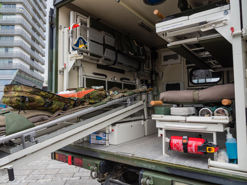 Military ambulance. ALMERE, NETHERLANDS - 23 APRIL 2014: A Dutch military medical vehicle on display during the National Army Day in Almere can be inspected by royalty free stock photography