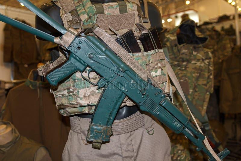 Military ammunition and Kalashnikov assault rifle close-up royalty free stock photo