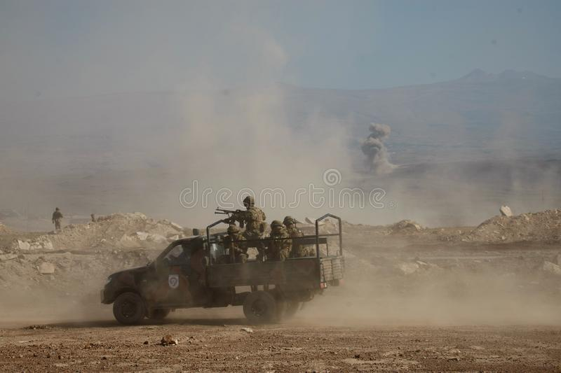 Military armed truck with soldiers on it during military training stock image