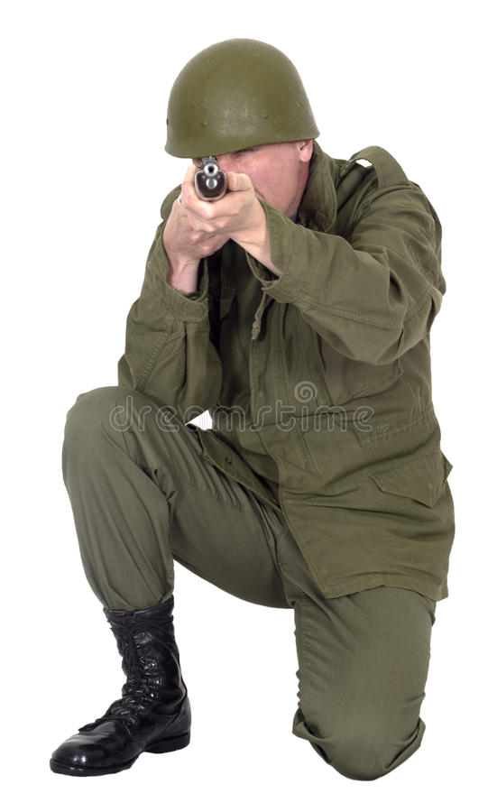 Military Army Soldier Shooting Rifle Gun, Isolated. A military army soldier is shooting a rifle gun. The uniform fatigues on the man are of a retro style royalty free stock photo