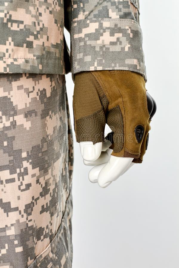 Military army uniform fingerless glove. Mannequin hand, close up. White isolated background royalty free stock photos