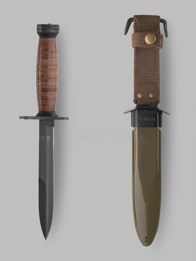 Military bayonet knife with scabbard. Photo of knife and scabbard on gray background with shadow stock photography