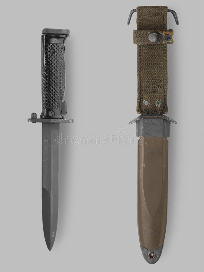 Military bayonet knife with scabbard. Photo of knife and scabbard on gray background with shadow royalty free stock images