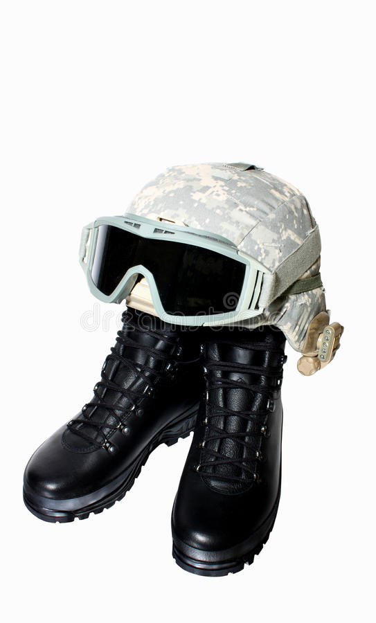 Military boots and helmet stock photo