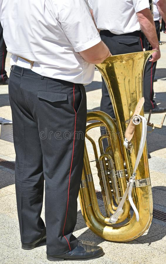 Military brass band members with instruments. In summer stock image