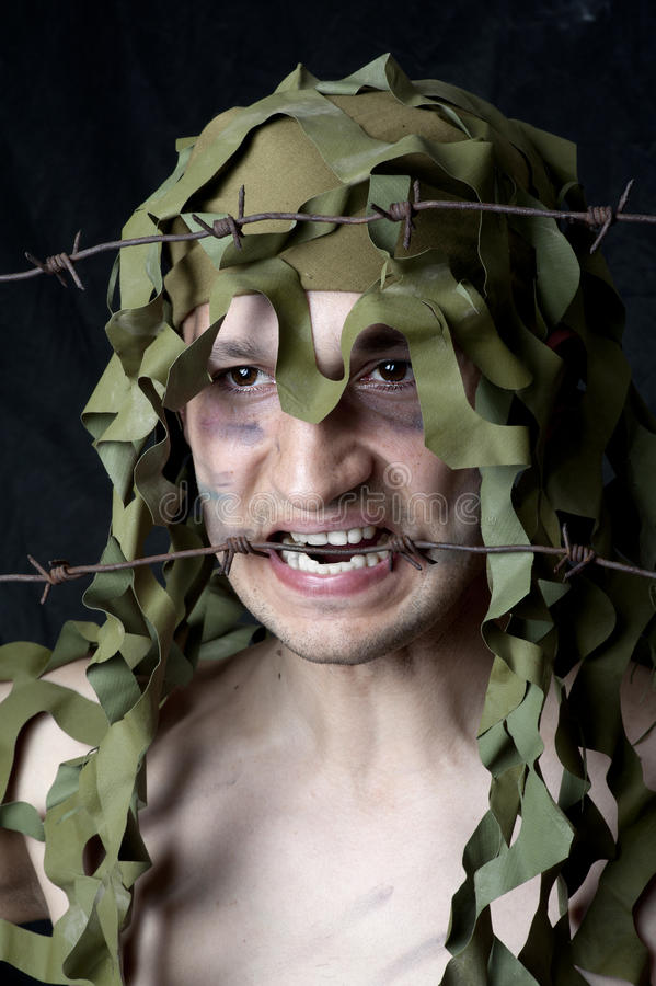 Download Military camouflaged man stock photo. Image of black - 25078642