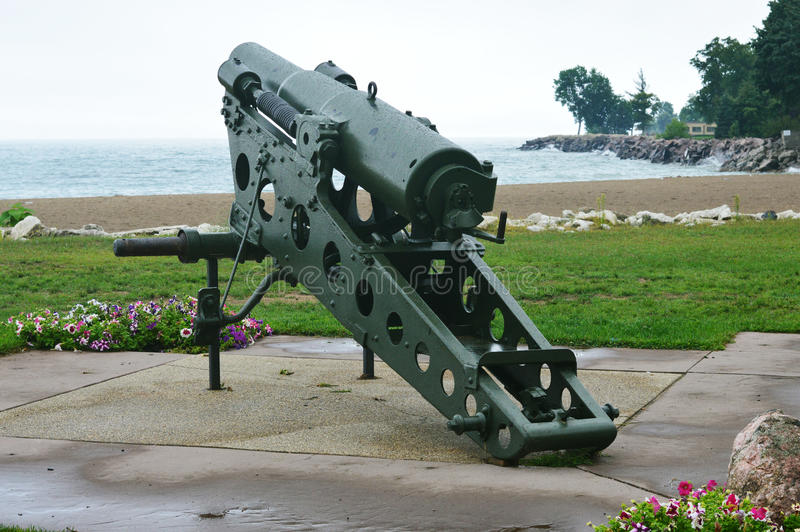 Military Cannon Aiming Over Lake Michigan. A military cannon aiming over Lake Michigan located at Eichelman park in Kenosha, Wisconsin royalty free stock photography