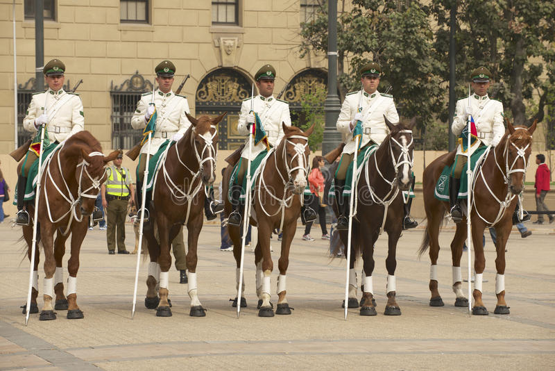 Military of the Carabineros band attend changing guard ceremony in front of the La Moneda presidential palace, Santiago, Chile. SANTIAGO, CHILE - OCTOBER 18 stock photos