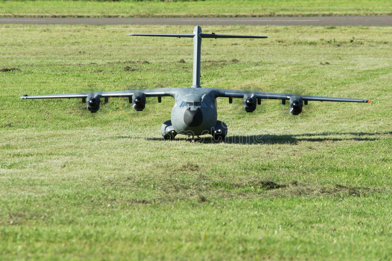 Military cargo airplane(A-400M)-landing on grass runway stock image