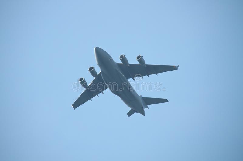 Military cargo plane flying over royalty free stock photo