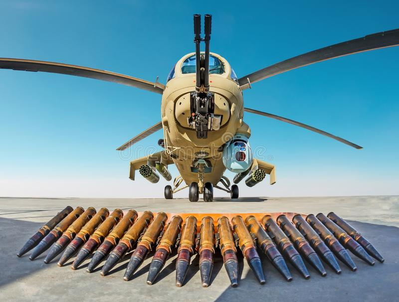 Military combat helicopter with ammunition shells on the ground stock photo