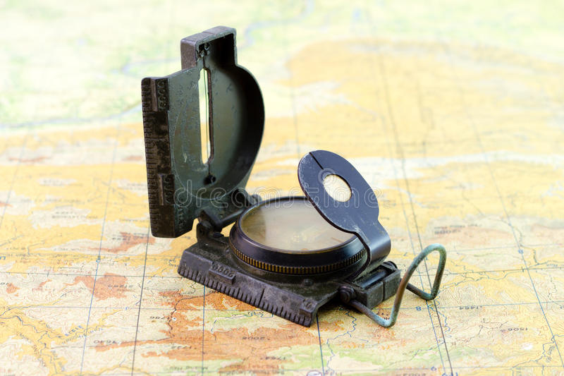 Military compass on the map. Old and dirty military compass on the map stock photo