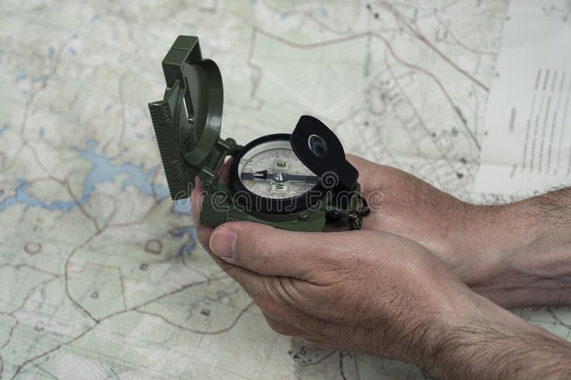 Compass and map reading survival outdoors. Military compass and map reading survival outdoors and military theme stock photography