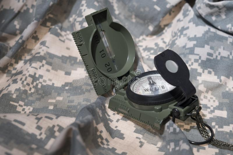 Compass and map reading survival outdoors. Military compass and map reading survival outdoors and military theme stock image