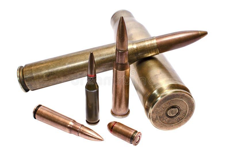 Military conceptioin: cartridges for large-caliber machine-gun, assault rifle and handgun royalty free stock image