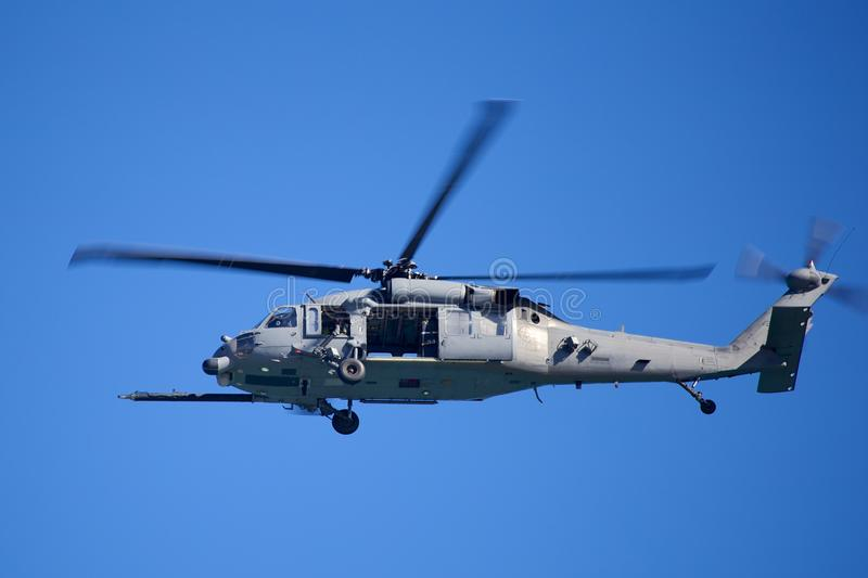 Military Copter. Picture of a United States Military Helicopter flying over Cocoa Beach against a blue sky stock images