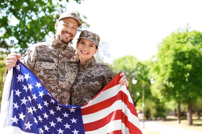 Military couple with American flag stock photography