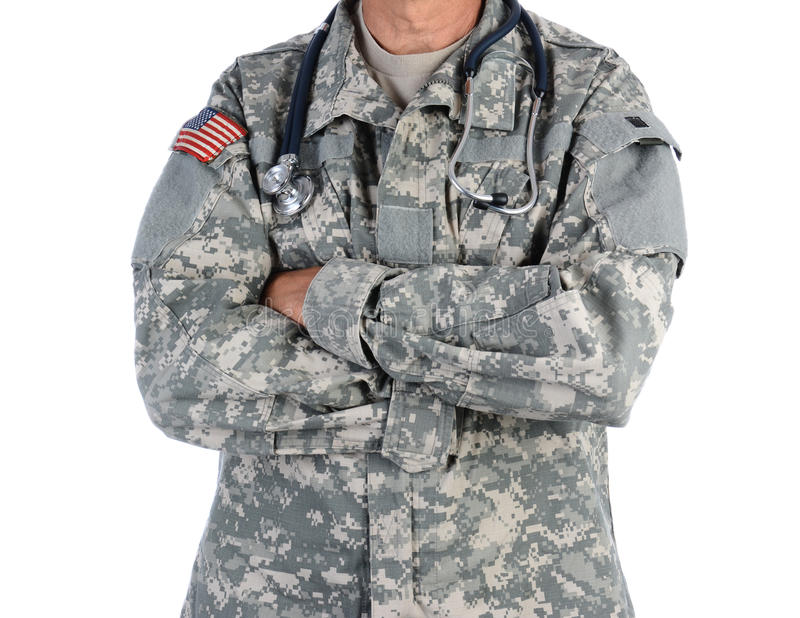 Military Doctor in Combat Uniform. Closeup of a military doctor with a stethoscope around his neck. The man is wearing camouflage fatigues also called ACU and royalty free stock image