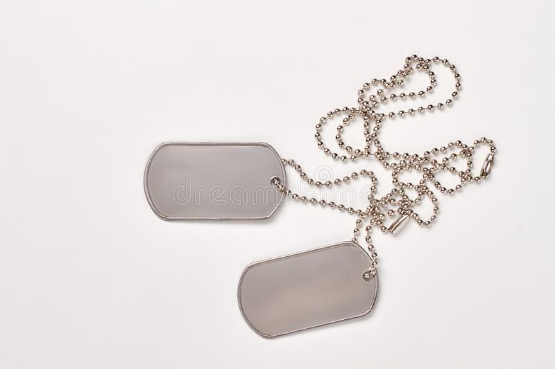 Military dog tags on white background. royalty free stock images