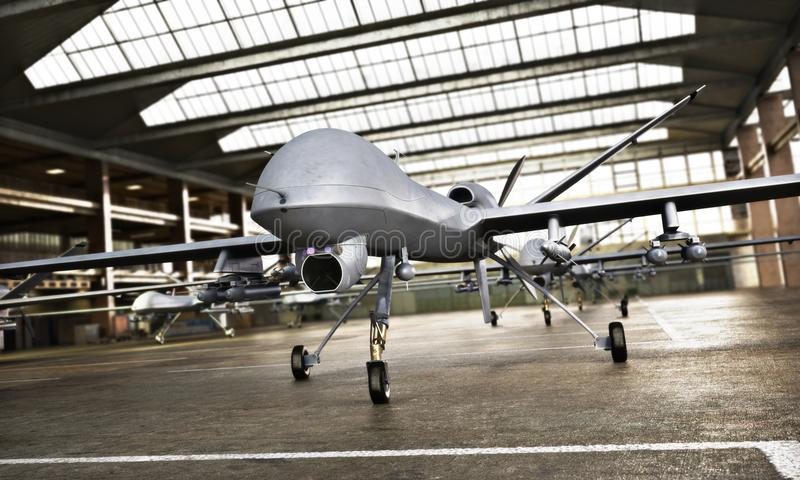 Military Drone UAV aircraft`s with ordinance in position in a hangar awaiting a strike mission. royalty free stock image