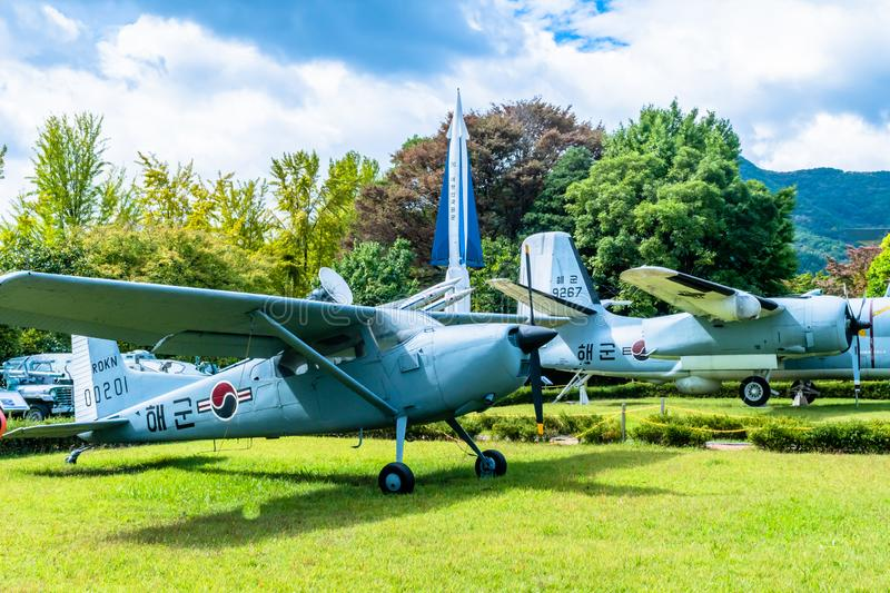 Military equipment on display. Daejeon, South Korea; October 3, 2019: Cessna 140 military trainer in front NIKE Hercules missile and other military equipment on royalty free stock photo