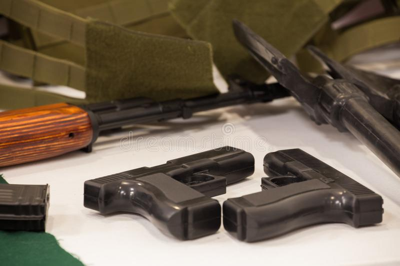 Military equipment, pistols and rifles. View of the military equipment, rifles stock image